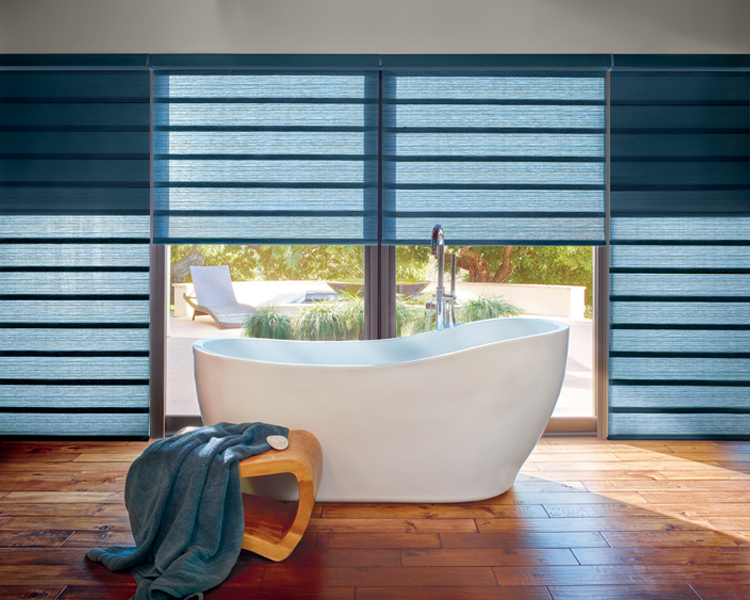 bohemian bathroom with stand alone tub and hunter douglas vignette modern roman shades on large window Reno