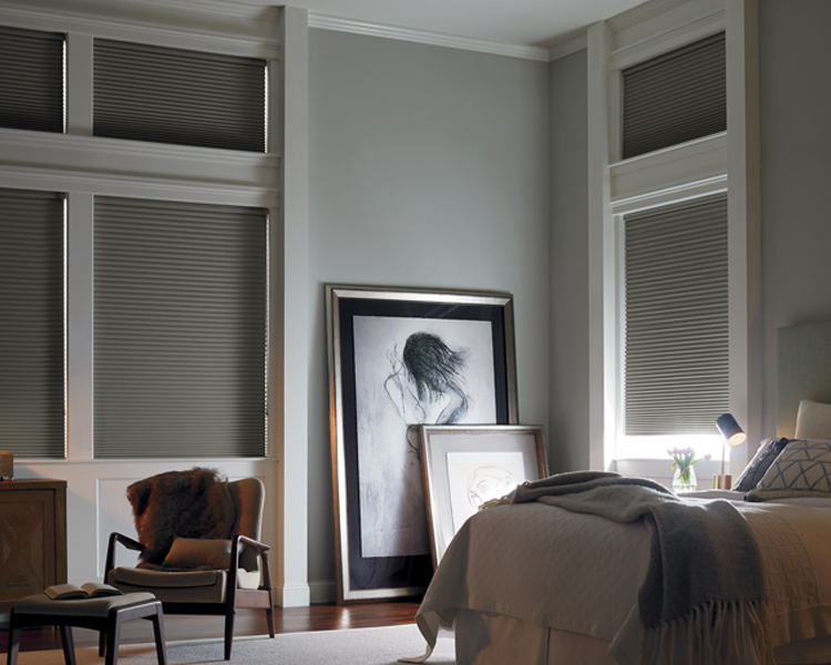 traditional master bedroom with blackout applause honeycomb shades by Hunter Douglas Reno