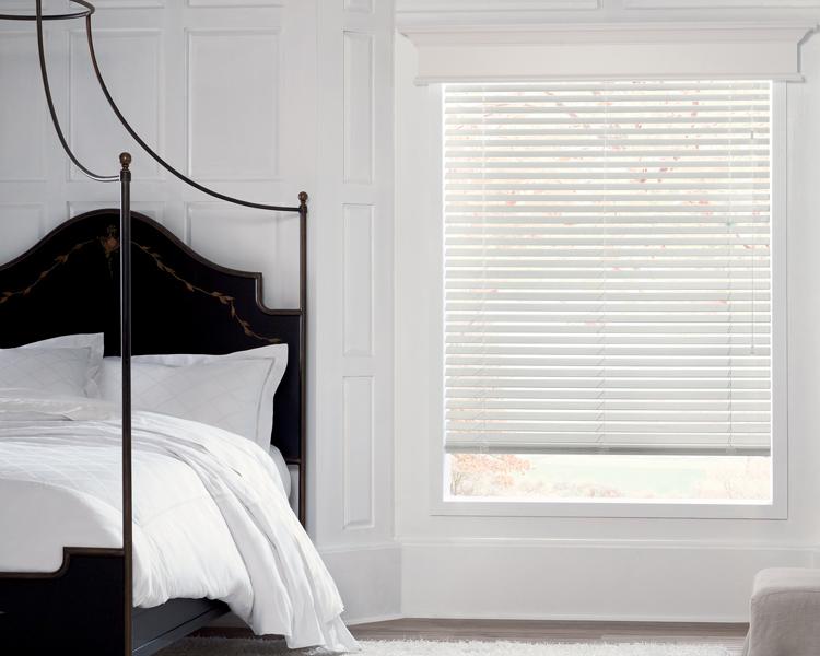 white blinds in white bedroom black bed in Reno NV