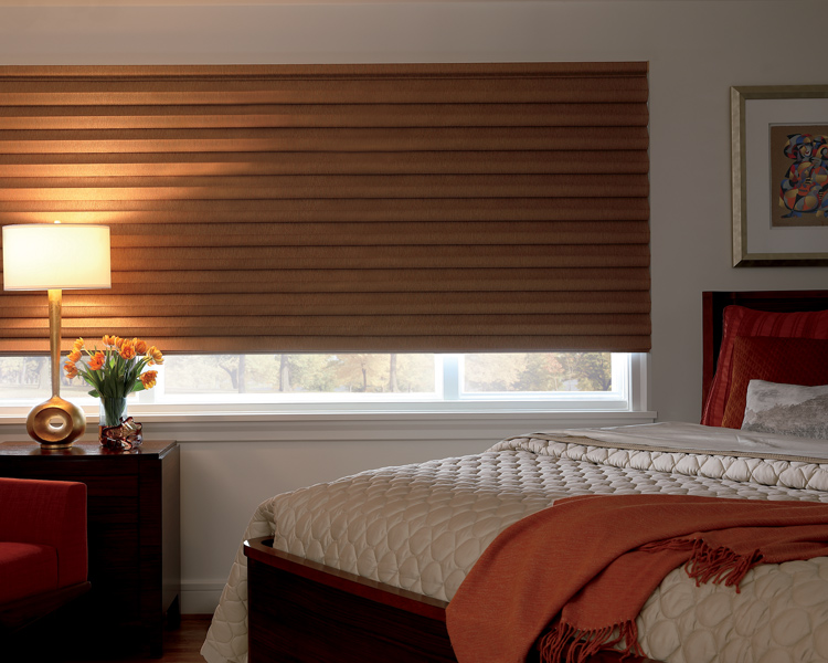 master bedroom with golden solera roman blackout shade by Hunter Douglas Reno