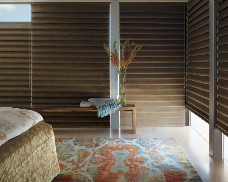 bohemian master bedroom with hunter woven vignette modern roman shade for room darkening in Reno 89520