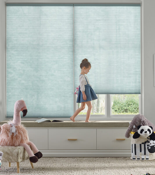 child's room with blue honeycomb cordess shades Reno