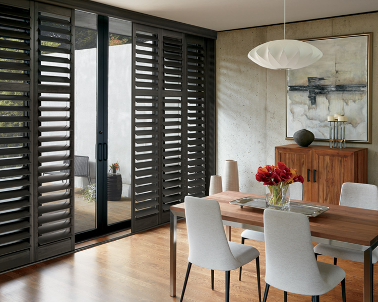 modern dining room with sliding glass doors and Hunter Douglas black plantation shutters Reno 89439