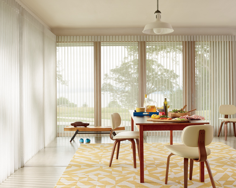 yellow dining room with hunter douglas luminette vertical shades on large windows