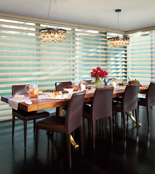 dining room with brown leather chairs and hunter douglas pirouette window shades by hunter douglas Reno