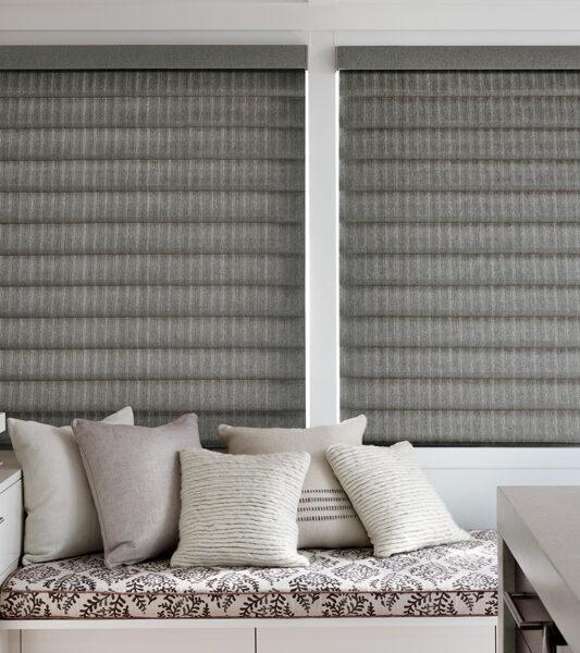 grey motorized vignette modern roman shades on large windows for insulating blinds by Hunter Douglas Reno
