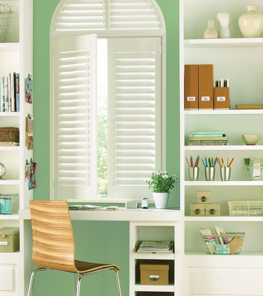 home office with green walls and Hunter douglas cordless plantation shutters in Reno
