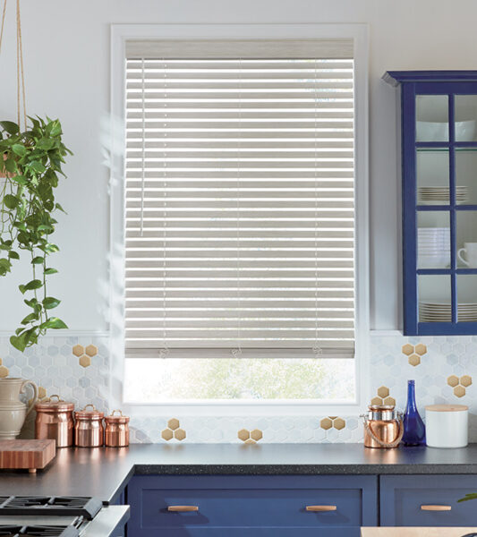 kitchen with navy blue counters and everwood cordless blinds Reno 89433