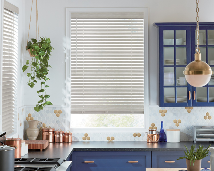 kitchen with navy blue counters and evewood cordless blinds by Hunter douglas Reno 89433