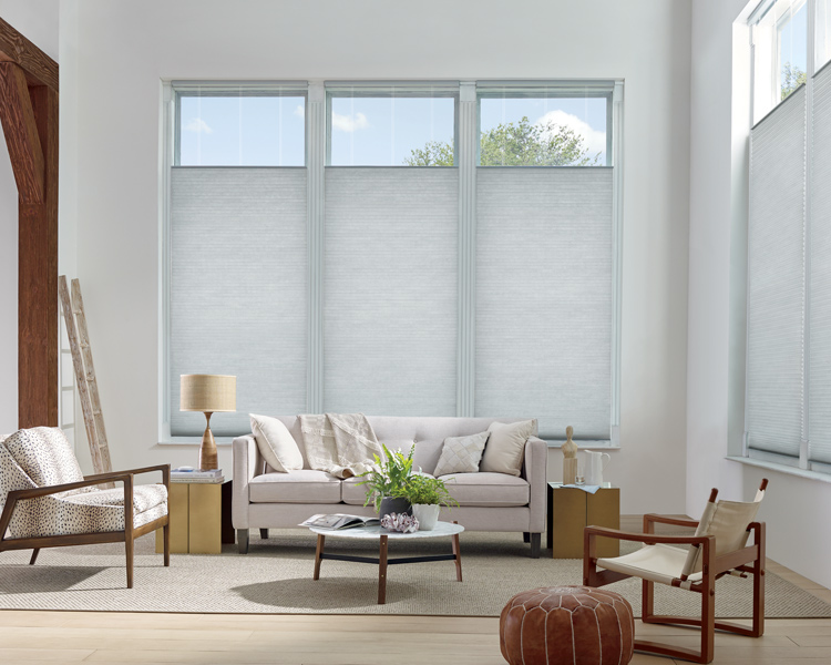 bohemian contemporary living room with light blue hunter douglas applause honeycomb top down bottom up shades Reno 89557