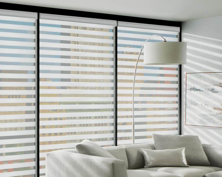 modern living room with white sofa and white hunter douglas designer banded shades on large window Reno