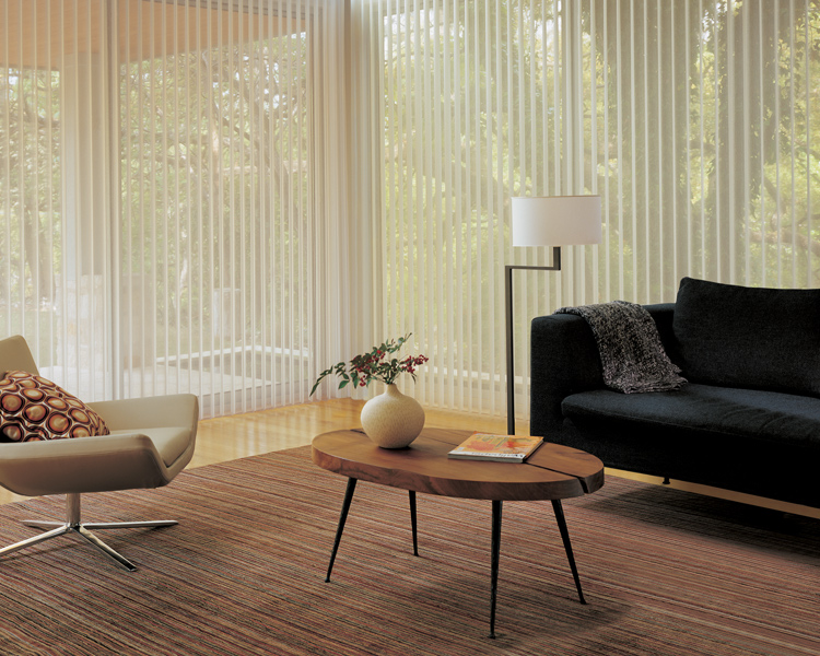 minimalistic living room with modern black sofa and luminette privacy sheer shades by hunter douglas on large windows in Reno