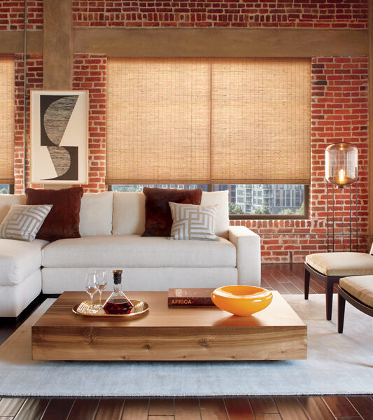 rustic living room with cordless child safe provenance woven wood shades by Hunter Douglas Reno