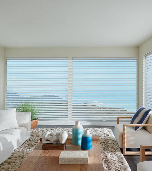 coastal living room with hunter douglas silhouette window shades on large window Reno 89570