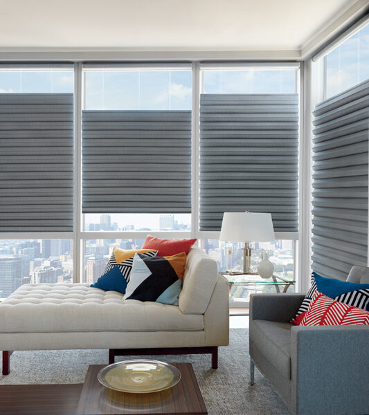 high rise conde with white sofa and grey top down bottom up solera soft romans shades by Hunter Douglas Reno