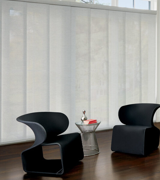 modern minimalistic living room with black chairs and skyline gliding window panels on sliding glass doors by Hunter Douglas Reno