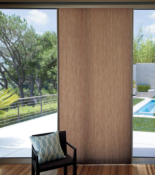 backyard with pool and hunter douglas duette vertiglide shades on sliding glass door in Reno 89511