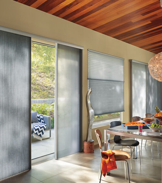 transitional contemporary loving room with pink crystal lamps and duette vertiglide shades on sliding glass doors by Hunter Douglas Reno