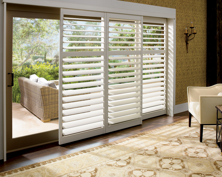 sliding glass doors with Hunter Douglas plantation shutters in Reno 89520