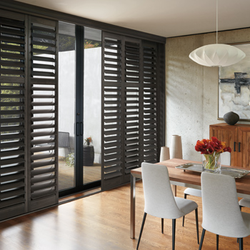 dining room with Hunter Douglas black plantation shutters on sliding glass doors window covering solutions Reno