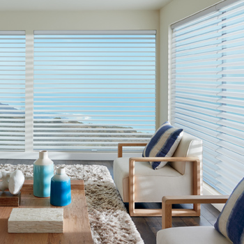 living room over looking the ocean when striped accent pillows and Hunter Douglas Large Window Blinds window solutions Reno