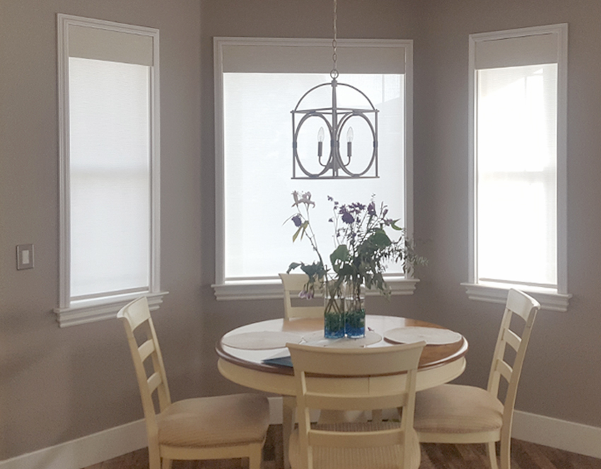dining room recent work with hunter douglas roller shades Reno
