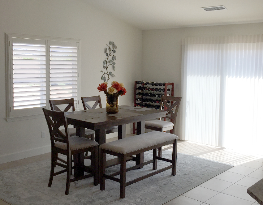 dining room with hunter douglas luminette shades on sliding glass doors recent work Reno