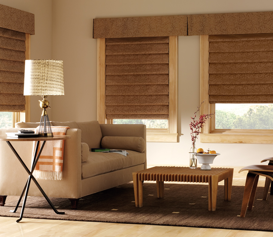 camel colored fabric roman shades with coordinating cornices Reno NV