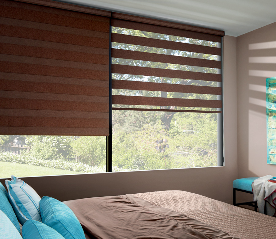 room darkening designer banded window roller shades in bedroom Reno NV