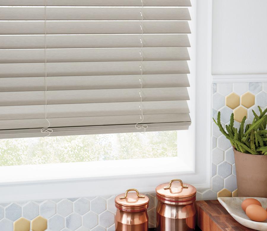 natural wood faux wood blinds in kitchen with honeycomb tile backsplash Reno NV