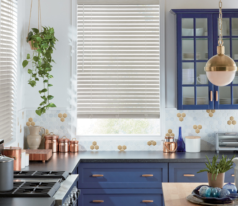 blue kitchen cabinets with white window blinds Reno NV