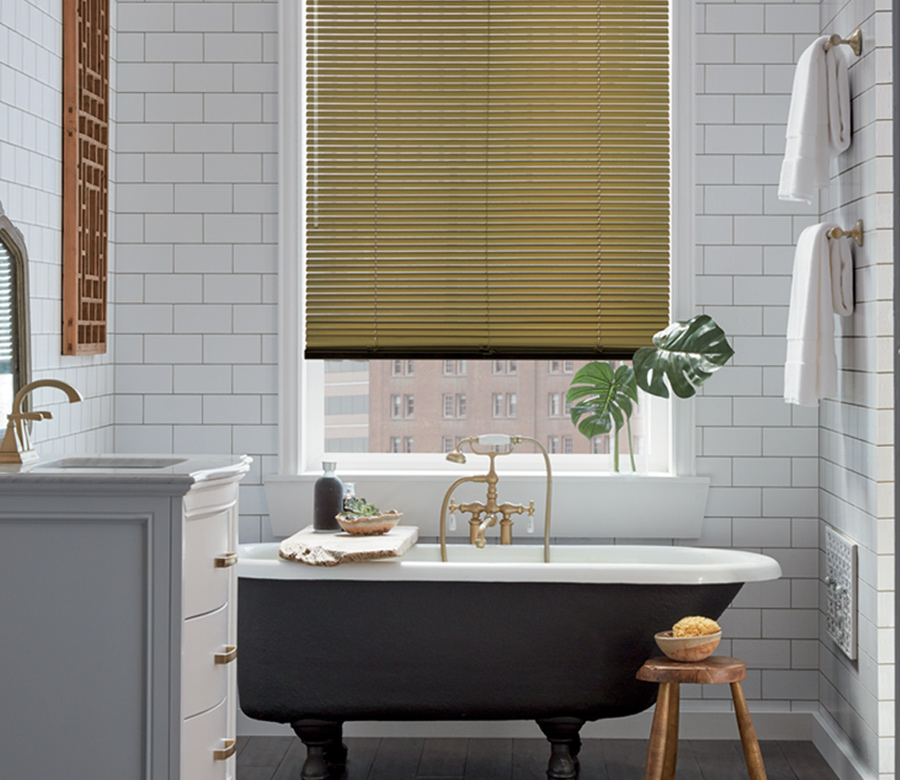 gold metal blinds against subway tile wall in bathroom Reno NV