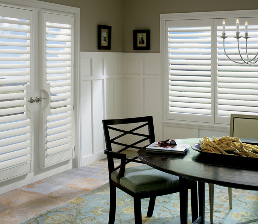 white vinyl shutters in dining room on french doors Reno NV