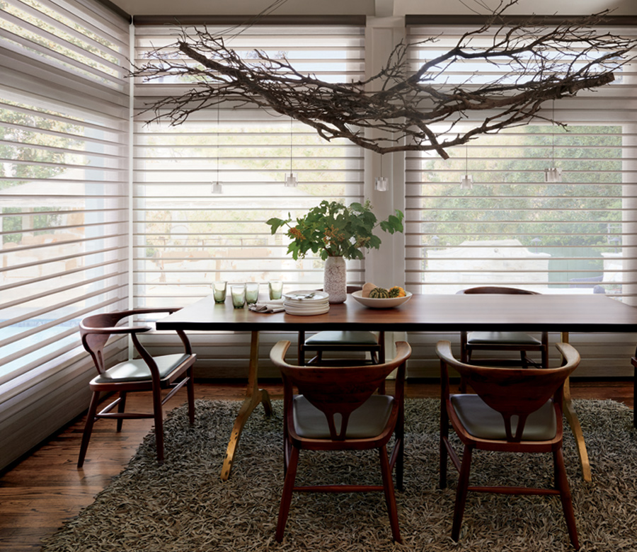 dining room with large windows and silhouette shades Reno NV