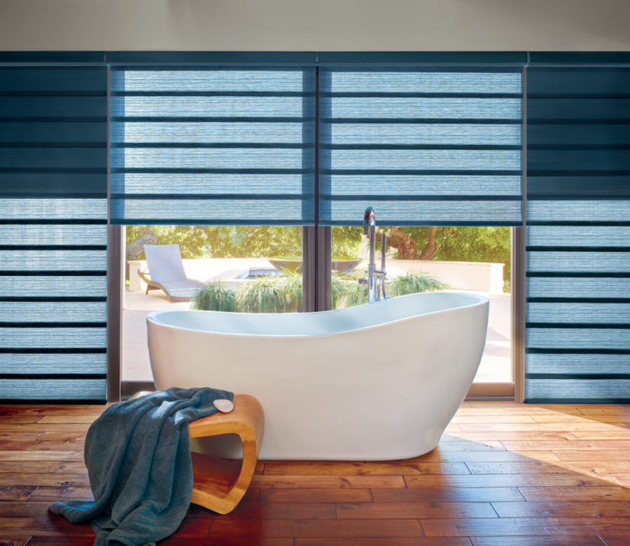 modern bathroom standalone tub with hunter douglas blue vignette modern roman shades Reno