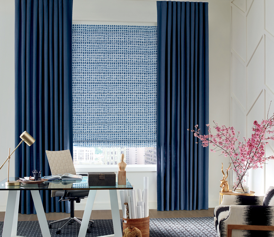 home office window covered in blue speckled roman shades with dark blue draperies Reno NV