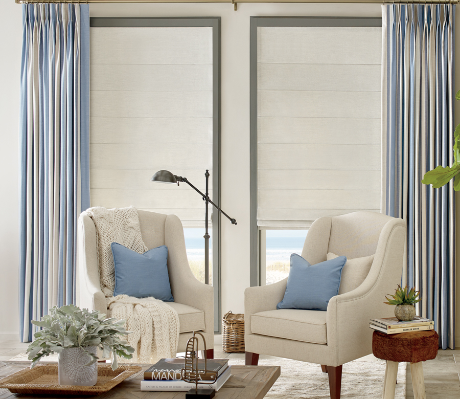 white design studio roman shades with blue striped curtains in sitting room Incline Village NV