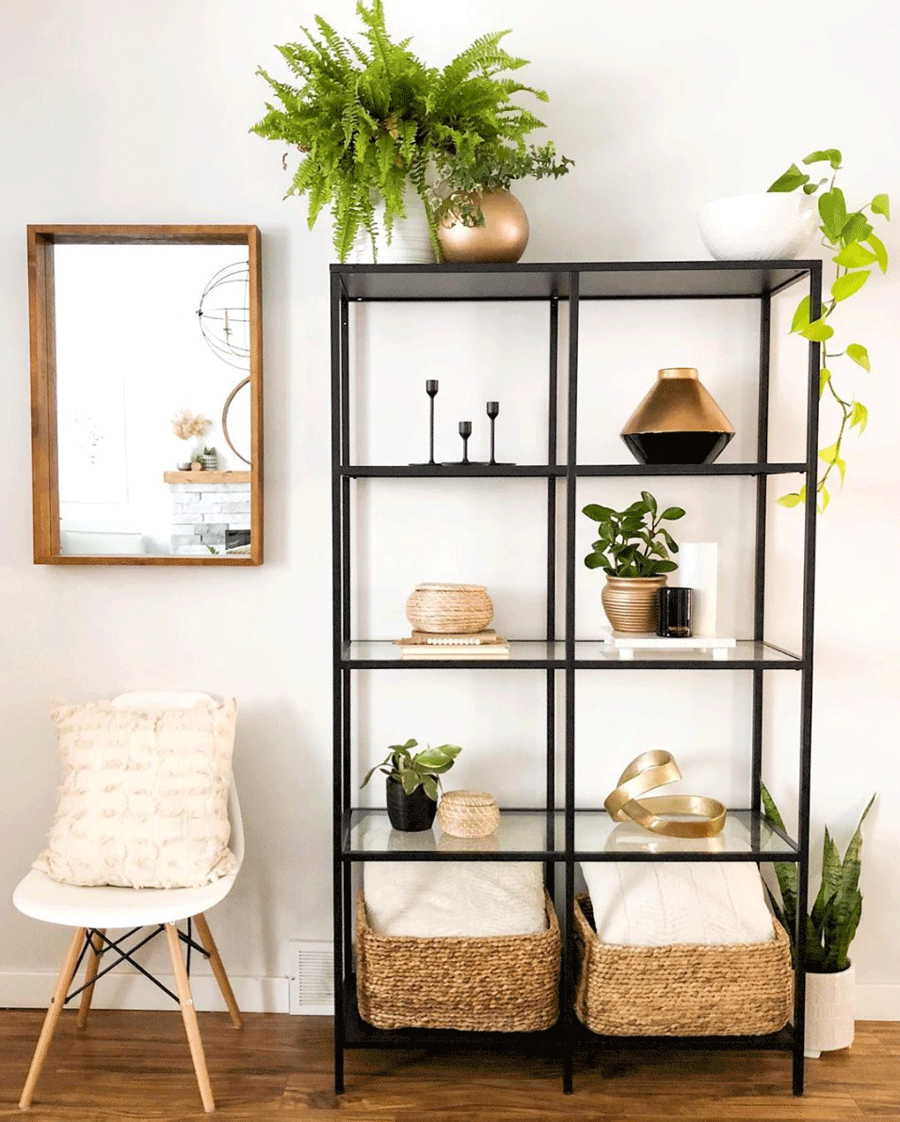 Accents of gold on black shelf