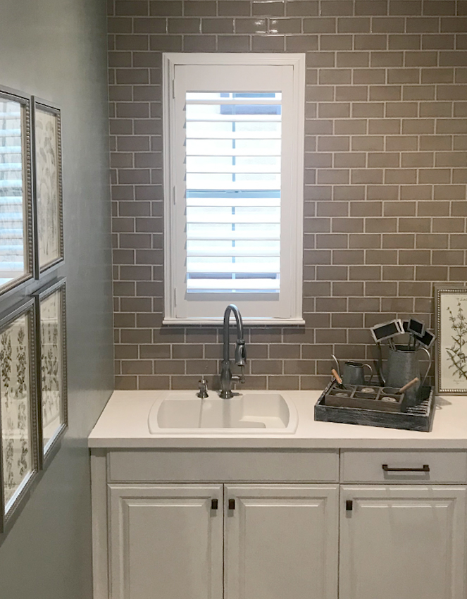 kitchen with gray tile backsplash and white plantation shutters Reno NV