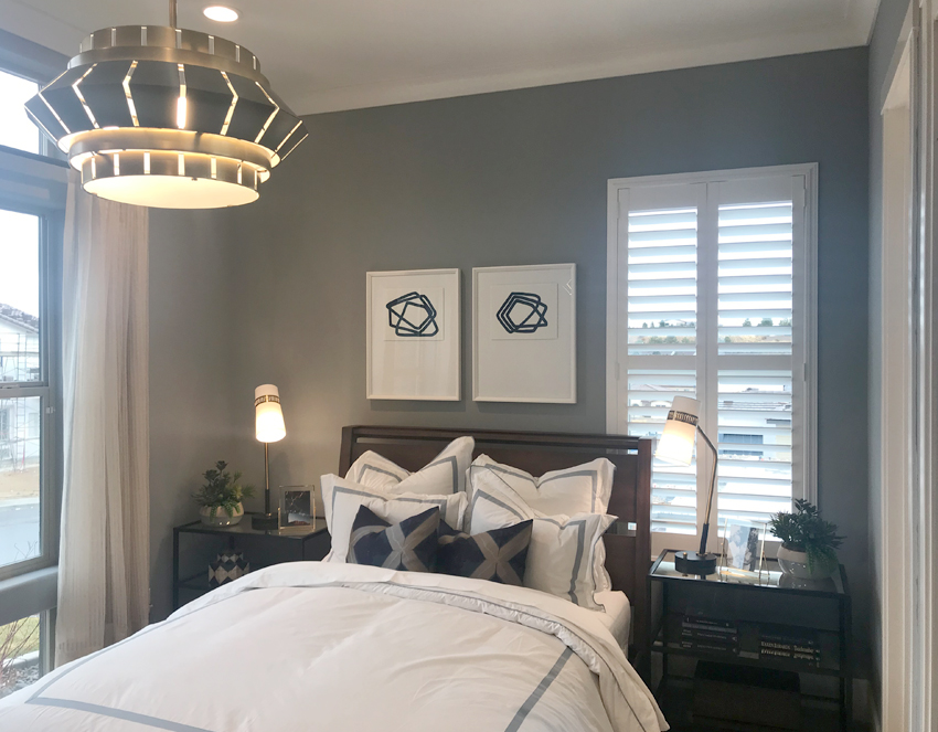 guest bedroom with white plantation shutters Reno NV