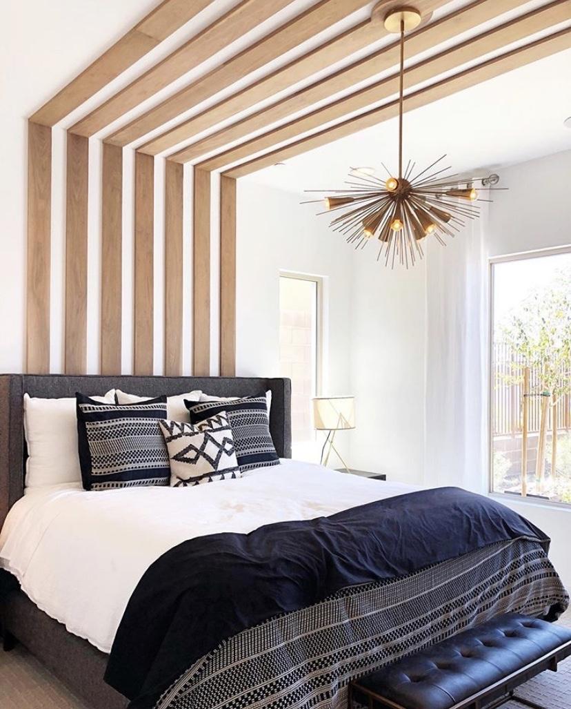 Focal light fixture in master bedroom.