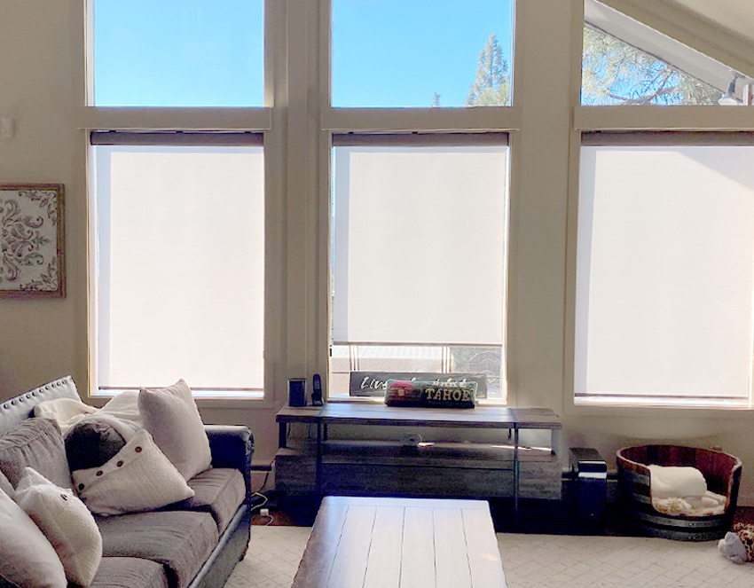 triple windows in living room with simple roller shades Reno NV