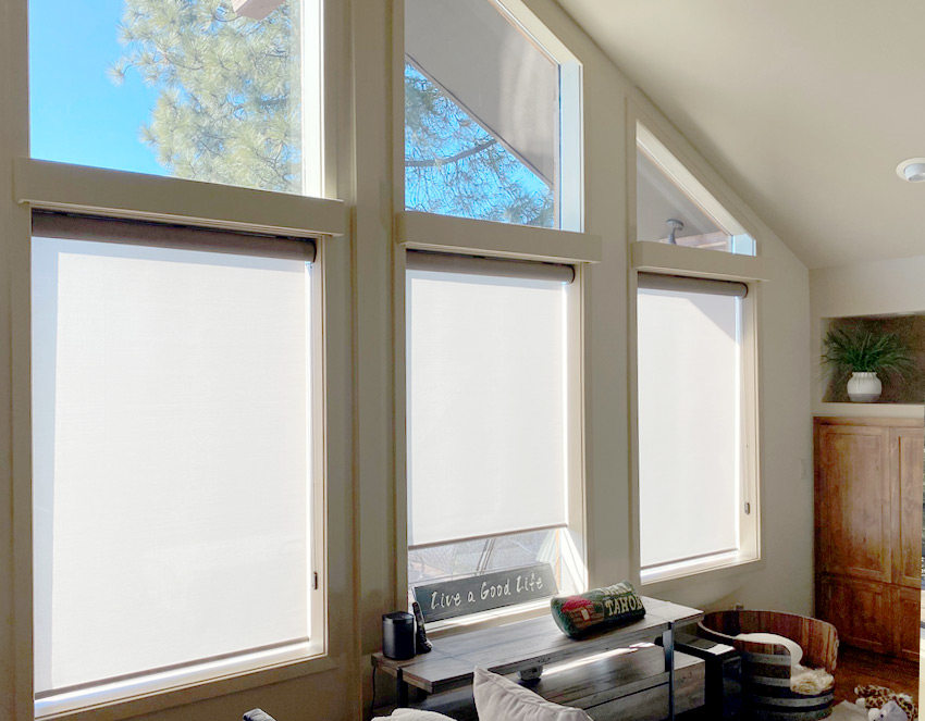 beige roller shades on lower living room windows Reno NV