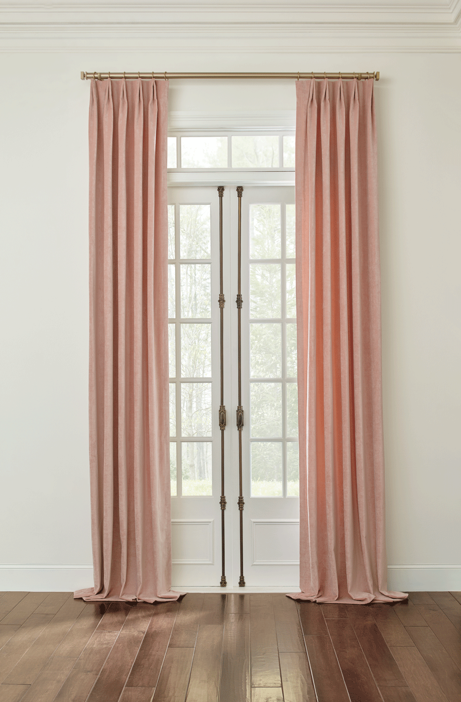 puddled pink drapery panels cover French doors