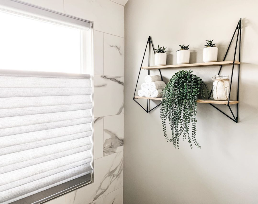 bathroom white contemporary with plant accents and wood and steel shelves reno