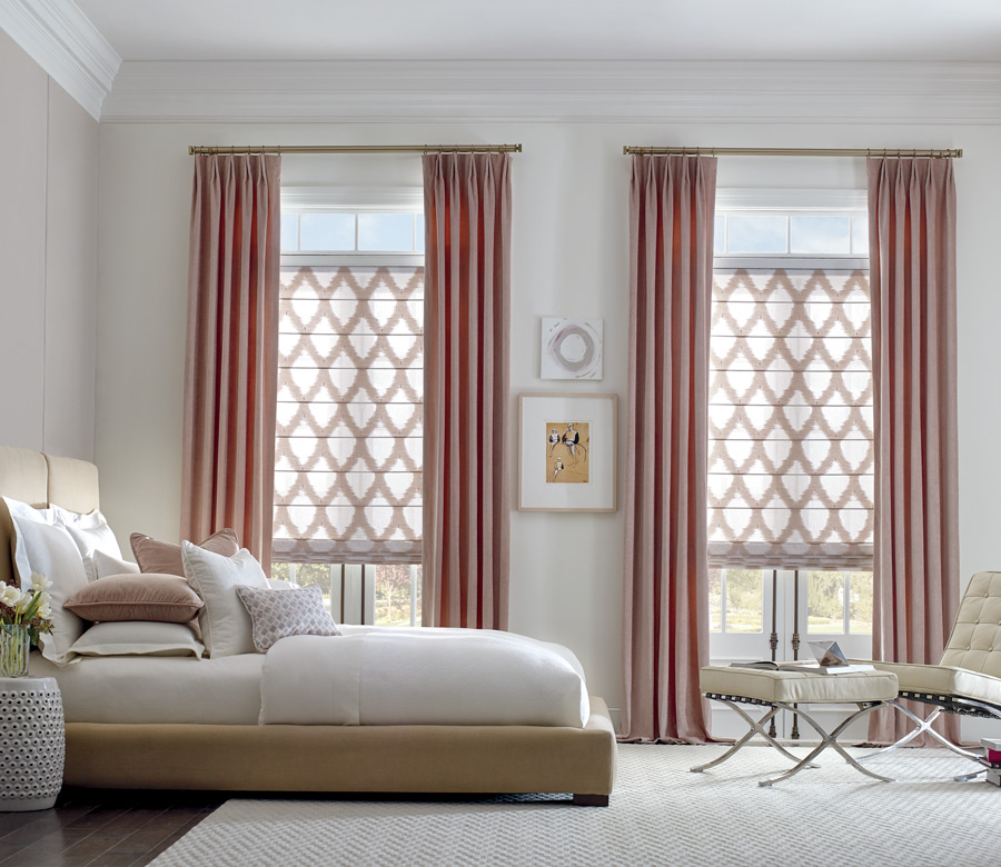 pinch pleat drapery panels with trellis pattern roman shades Incline Village, NV