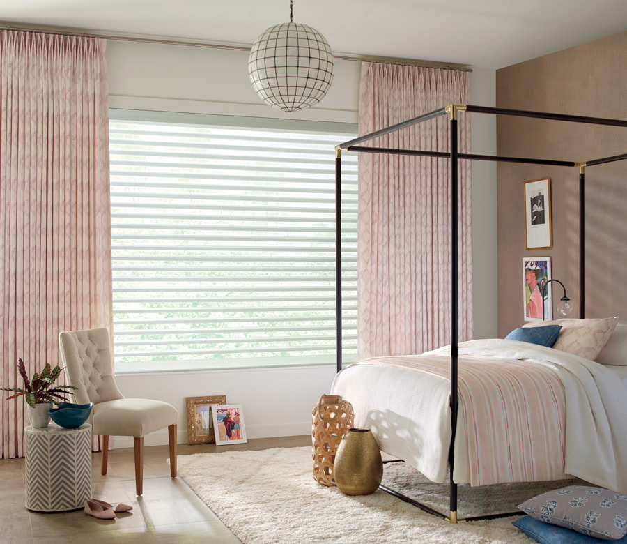 soft pink custom draperies with white window shades bedroom in Reno NV