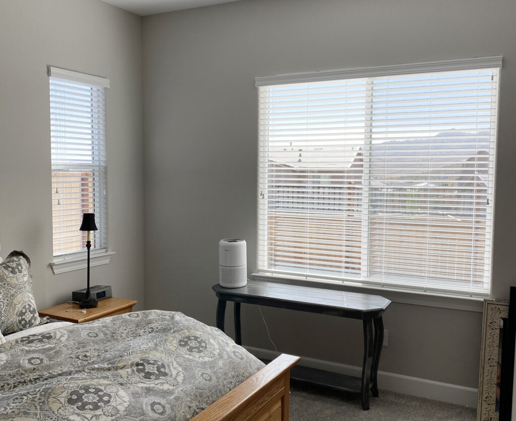 white hunter douglas blinds in Reno NV bedroom
