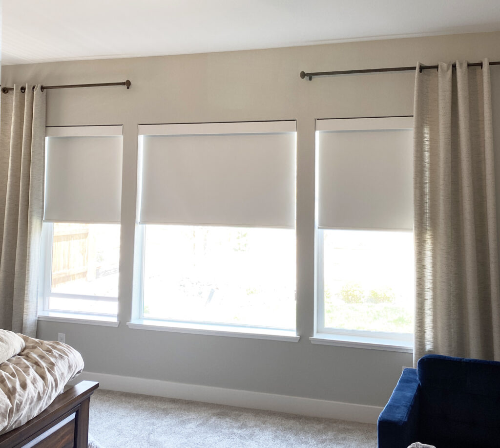 three windows in living room with modern white roller shades in Reno NV