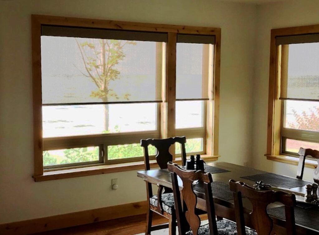 designer screen roller shades in dining room in Reno NV